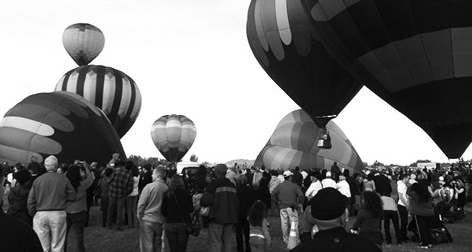 Hot air balloons being filled at an event.