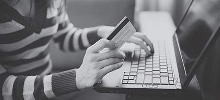 Young woman checking her debit card balance online.
